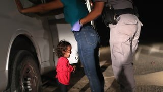 toddler crying with border agent at mexico us border